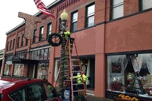 Wreaths being hung by City staff Downtown Snohomish